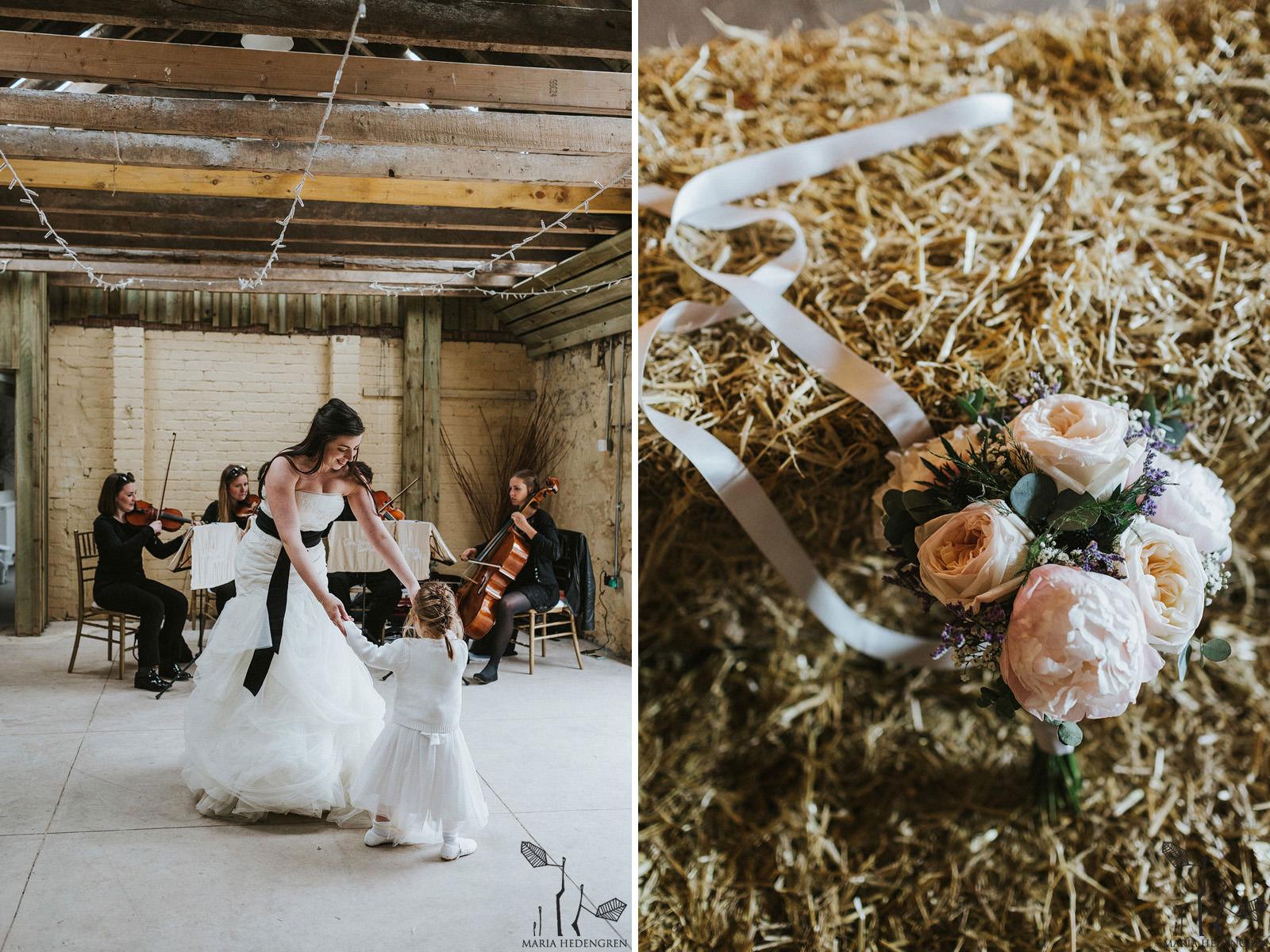bride dancing with flowergirl