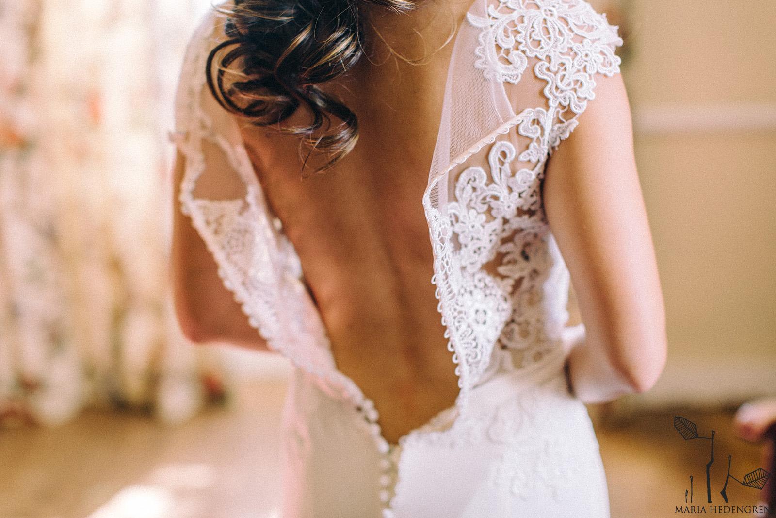 bride puttin on her gown