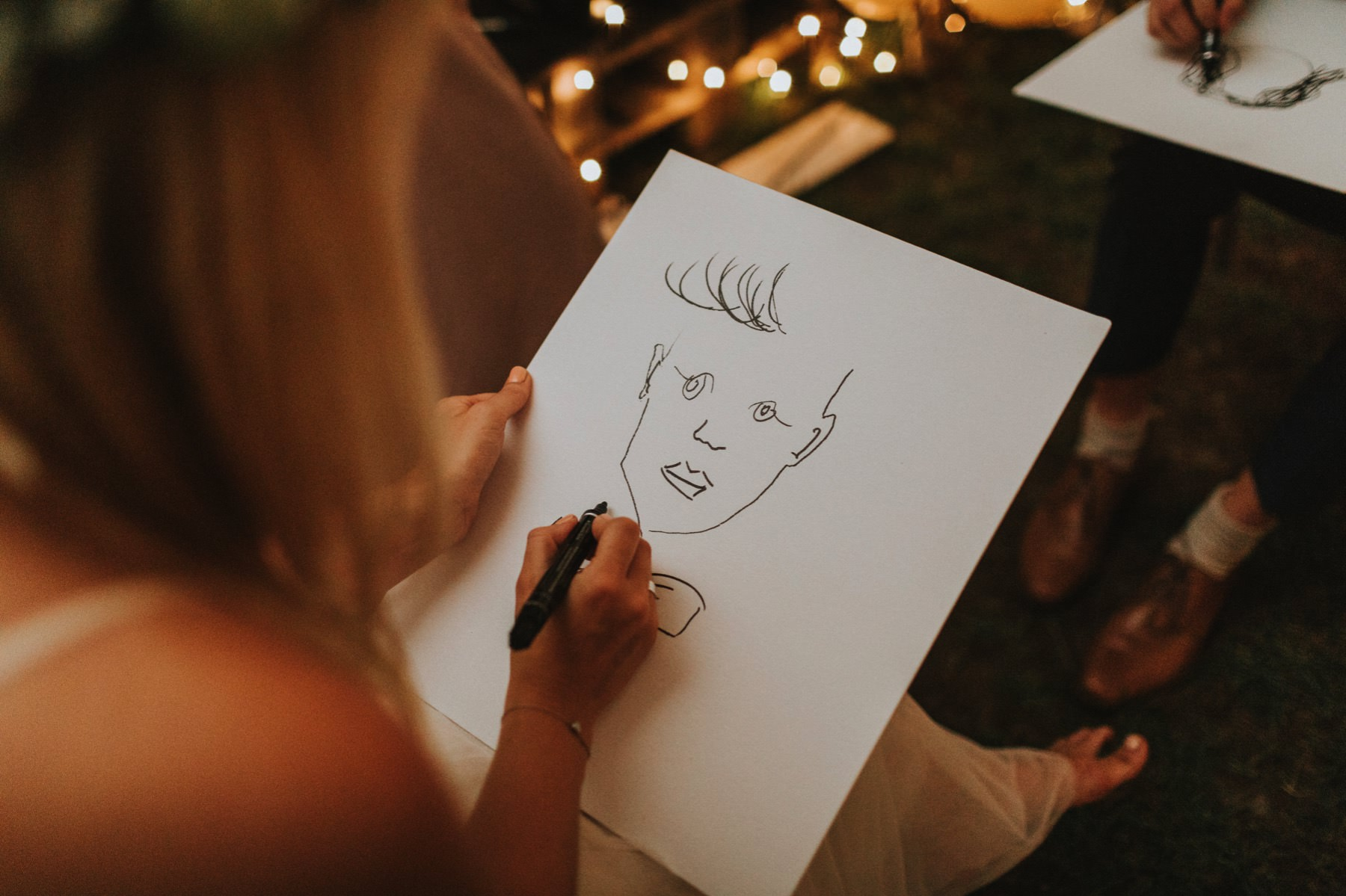 bride drawing a portrait